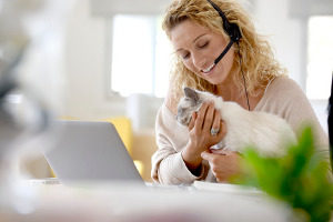 woman holding her cat and talking to a Northern VA cat sitting service reference