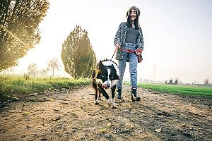 a lady walking her dog as she usually does for around 45 minutes per day
