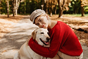 a dog being embraced by her owner after a walk